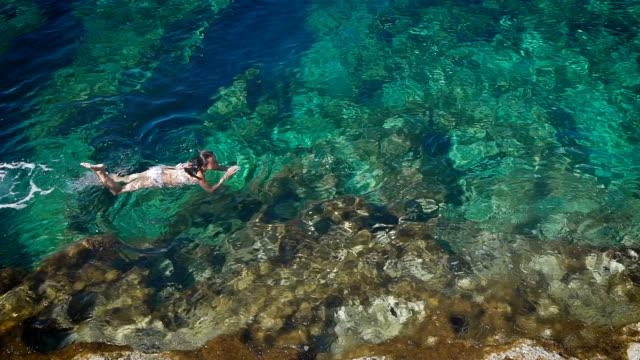 Young woman swimming in beautiful azure sea in Cyprus video