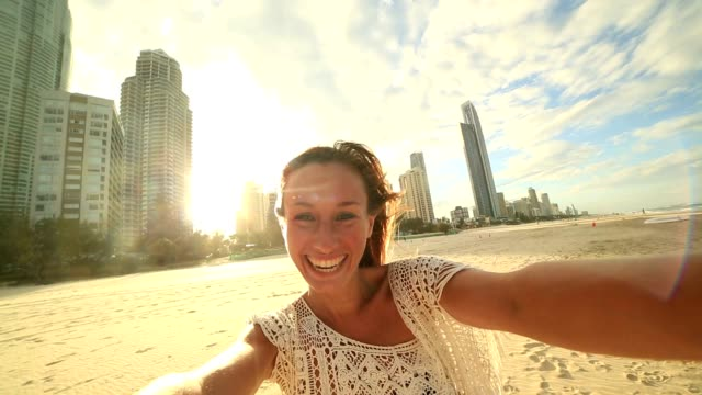 Young woman takes a selfie portrait at Surfer's paradise beach video