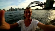 Young woman takes a selfie with Sydney skyline video