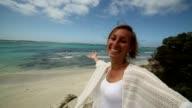 Young woman takes self portrait on kangaroo island video