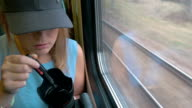 Young Woman Taking A Photo On Train video