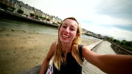 Young woman taking a selfie in Trouville harbour,Normandy-France video