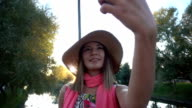 Young woman taking a selfie portrait video