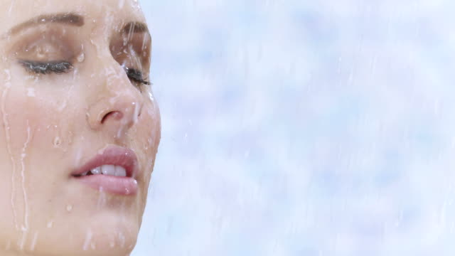 Young woman taking a shower in slow motion video