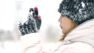 Young Woman taking photo during snowfall video
