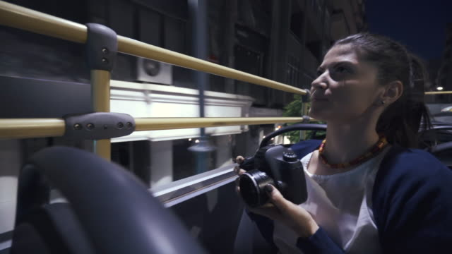 Young woman taking photos, sightseeing in the tourist bus. video