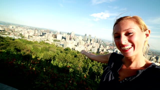 Young woman taking selfie in Montreal video