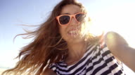 Young woman taking selfie on the beach in slow motion video