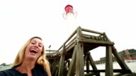 Young woman taking selfie with lighthouse in Normandy video