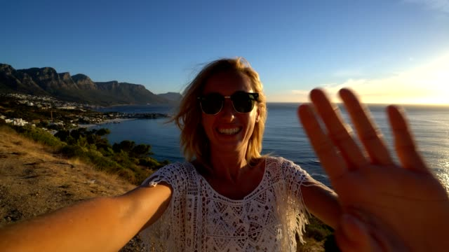 Young woman taking selfie with seascape, Cape Town video