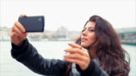 Young Woman Taking Selfies Near The Sea In City video