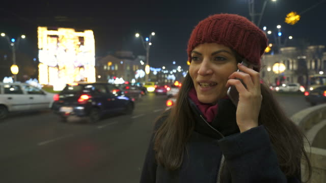Young woman talking at mobile phone. video