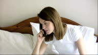 Young woman talking on cell phone video