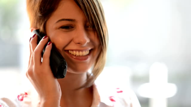 Young woman talking on the phone video