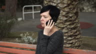 Young woman talking on the smartphone video
