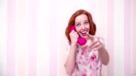 Young Woman Talking Silly On The Telephone video