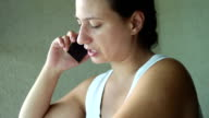 Young woman talking to her mobile phone video