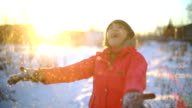 Young Woman throwing snow slowmotion video