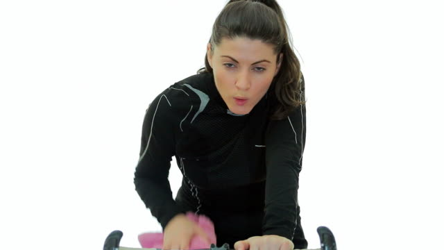 Young woman tired working out on bicycle. video