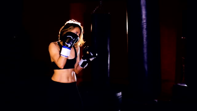 Young woman training, boxing slowmotion. video