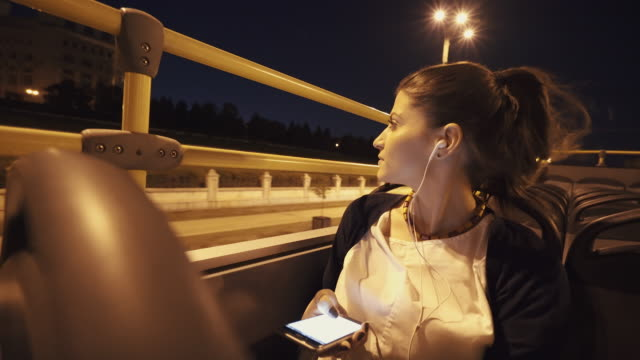 Young woman traveling with the tourist bus in the city. video