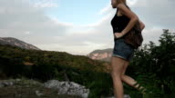 Young woman trekking video