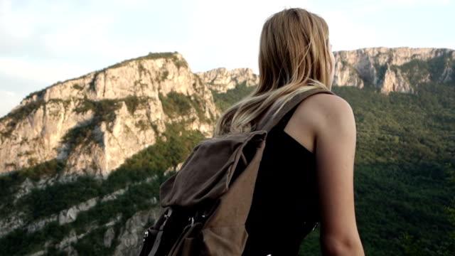 Young woman trekking video
