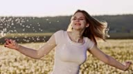 SLO MO Young woman twirling with dandelion seeds video