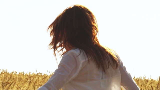 Young Woman Twirls in a Field video