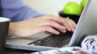 Young woman typing on laptop keyboard. video