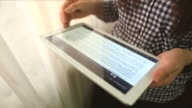 Young woman using a digital tablet. video