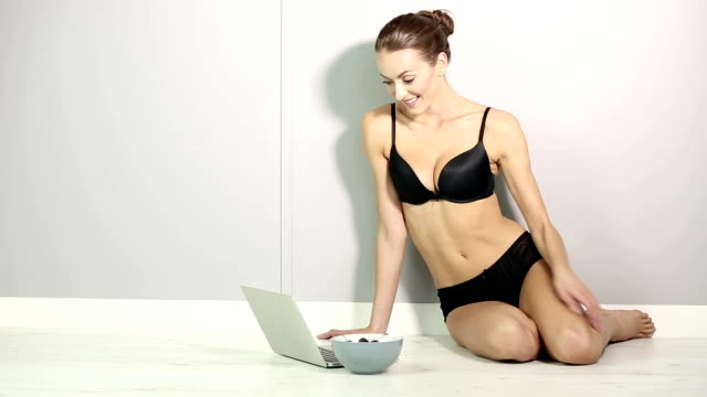 Young woman using a laptop laughing video