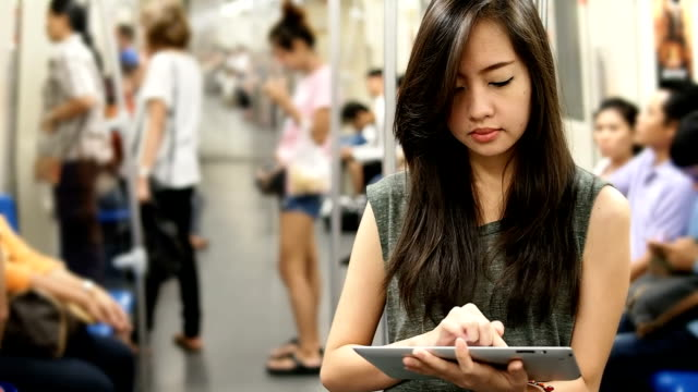 Young woman using a tablet video
