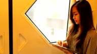 Young woman using digital tablet video