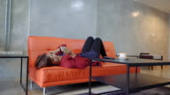 young woman using her mobile phone in living room video