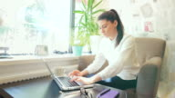 Young woman using laptop. video