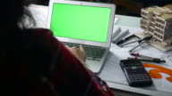 Young woman using Laptop with green screen video