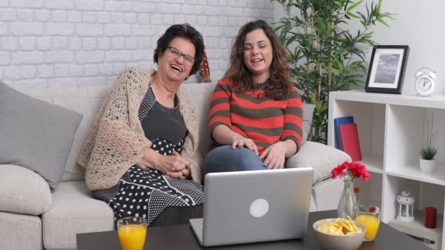 Young woman using Laptop With Her Granny video