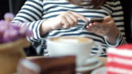 Young woman using smartphone at coffee cafe in relaxing time video