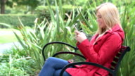 Young woman using smartphone video