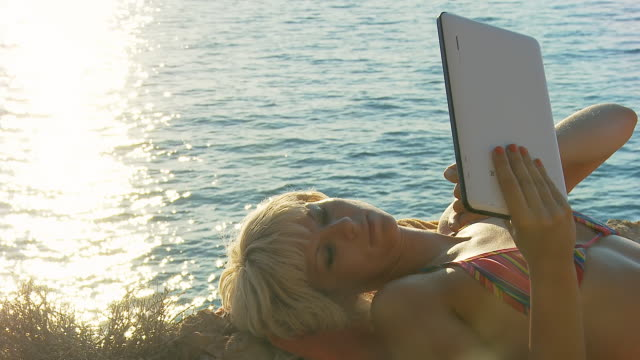 HD DOLLY: Young Woman Using Tablet On The Beach video