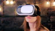 Young woman using Virtual Reality Glasses video