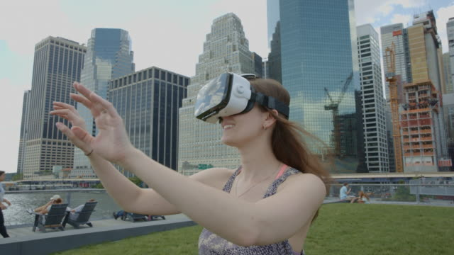 Young woman virtual reality googles headset downtown Manhattan NYC video