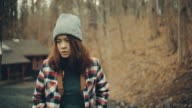 Young woman walk in the forest video
