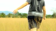 young woman walk into yellow field video