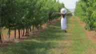HD Young woman walking at garden video