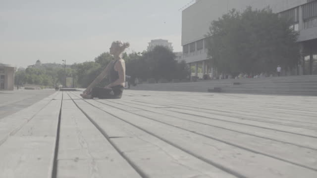 A young woman walking barefoot on wooden flooring video