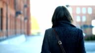 Young woman walking in an urban environment video
