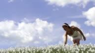 SLOW MOTION: Young woman walking in flower field video