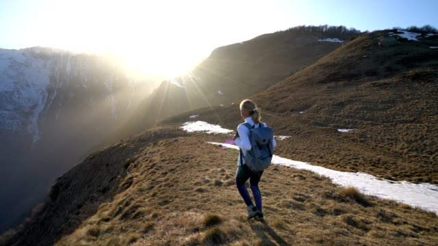 Young woman walking on hike in Switzerland video